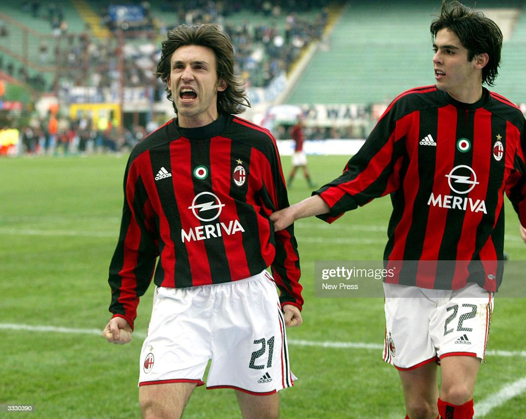 Pirlo celebrates a goal with Kaka during the Serie A match between Milan and Empoli April 10, 2004 in Milan, Italy.