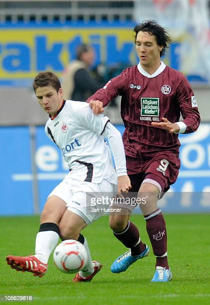 Pirmin Schwegler of Eintracht Frankfurt and Srdjan Lakic of 1 FC Kaiserslautern battle for the ball during the Bundesliga match between 1 FC...