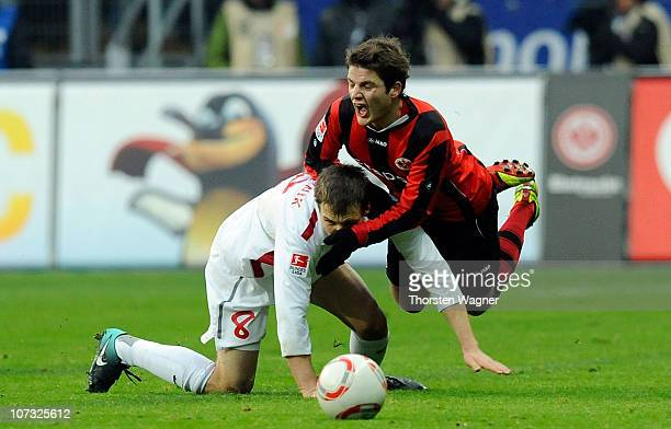 Pirmin Schwegler of Frankfurt battles for the ball with Radoslav Zabavnik of Mainz during the Bundesliga match between Eintracht Frankfurt and FSV...
