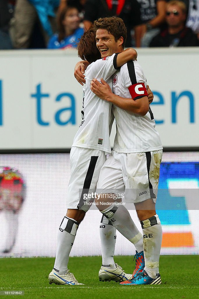 <a gi-track='captionPersonalityLinkClicked' href=/galleries/search?phrase=Pirmin+Schwegler&family=editorial&specificpeople=604263 ng-click='$event.stopPropagation()'>Pirmin Schwegler</a> (R) of Frankfurt celebrates his goal with <a gi-track='captionPersonalityLinkClicked' href=/galleries/search?phrase=Takashi+Inui&family=editorial&specificpeople=7174976 ng-click='$event.stopPropagation()'>Takashi Inui</a> (L) of Frankfurt during the Bundesliga match between 1899 Hoffenheim and Eintracht Frankfurt at Rhein-Neckar-Arena on September 1, 2012 in Sinsheim, Germany.