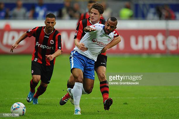 Pirmin Schwegler of Frankfurt challenges Mohammed Lartey of Rostock during the Second Bundesliga match between Eintracht Frankfurt and Hansa Rostock...