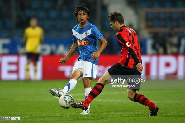 Pirmin Schwegler of Frankfurt challenges Takashi Inui of Bochum during the Second Bundesliga match between VfL Bochum and Eintracht Frankfurt at...