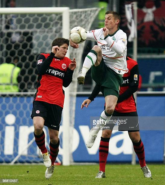 Pirmin Schwegler of Frankfurt is challenged by Markus Rosenberg of Bremen during the Bundesliga match between Eintracht Frankfurt and Werder Bremen...