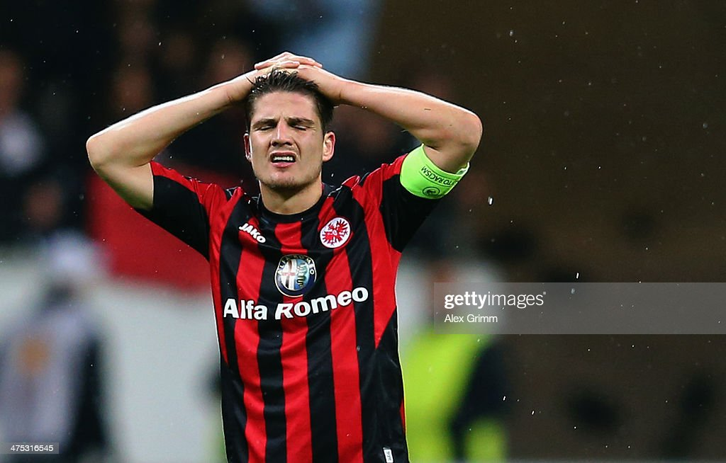 <a gi-track='captionPersonalityLinkClicked' href=/galleries/search?phrase=Pirmin+Schwegler&family=editorial&specificpeople=604263 ng-click='$event.stopPropagation()'>Pirmin Schwegler</a> of Frankfurt reacts after the UEFA Europa League Round of 32 second leg match between Eintracht Frankfurt and FC Porto at Commerzbank Arena on February 27, 2014 in Frankfurt am Main, Germany.