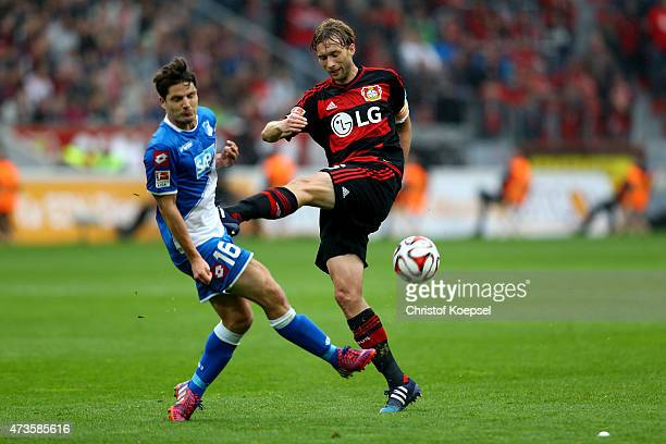 Pirmin Schwegler of Hoffenheim blocks a shot of Simon Rolfes of Leverkusen during the Bundesliga match between Bayer 04 Leverkusen and 1899...