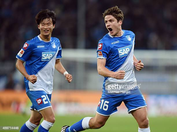 Pirmin Schwegler of Hoffenheim celebrates with his teammates after scoring his team's first goal during the Bundesliga match between 1899 Hoffenheim...