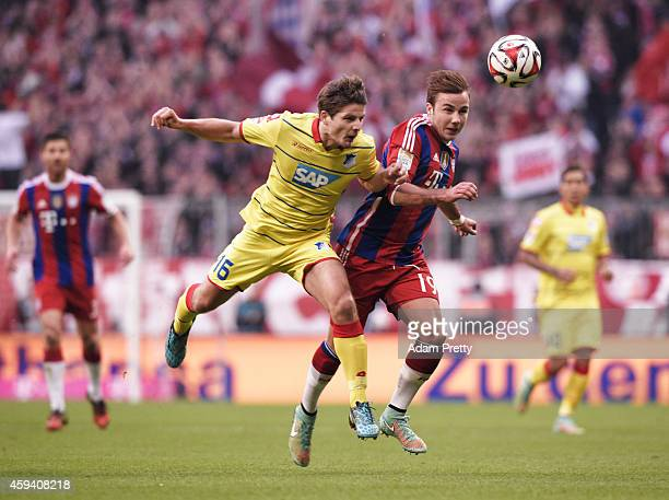 Pirmin Schwegler of Hoffenheim challenges Mario Goetze of Bayern Muenchen during the Bundesliga match between FC Bayern Muenchen and 1899 Hoffenheim...