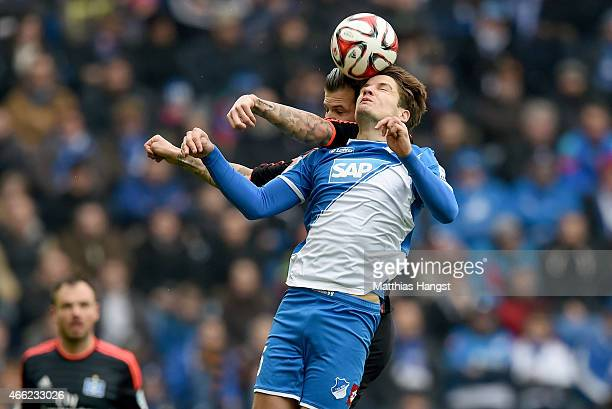 Pirmin Schwegler of Hoffenheim jumps for a header with Dennis Diekmeier of Hamburg during the Bundesliga match between 1899 Hoffenheim and Hamburger...