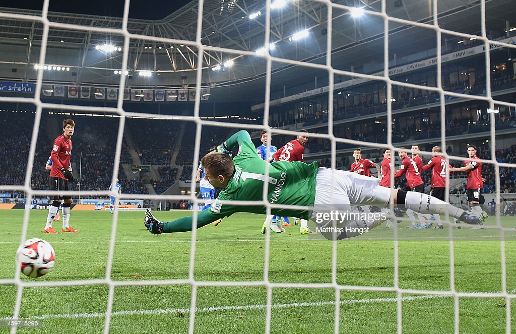 <a gi-track='captionPersonalityLinkClicked' href=/galleries/search?phrase=Pirmin+Schwegler&family=editorial&specificpeople=604263 ng-click='$event.stopPropagation()'>Pirmin Schwegler</a> of Hoffenheim scores his team's first goal past goalkeeper <a gi-track='captionPersonalityLinkClicked' href=/galleries/search?phrase=Ron-Robert+Zieler&family=editorial&specificpeople=727037 ng-click='$event.stopPropagation()'>Ron-Robert Zieler</a> of Hannover during the Bundesliga match between 1899 Hoffenheim and Hannover 96 at Wirsol Rhein-Neckar-Arena on November 29, 2014 in Sinsheim, Germany.