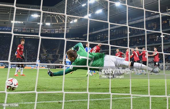 Pirmin Schwegler of Hoffenheim scores his team's first goal past goalkeeper RonRobert Zieler of Hannover during the Bundesliga match between 1899...