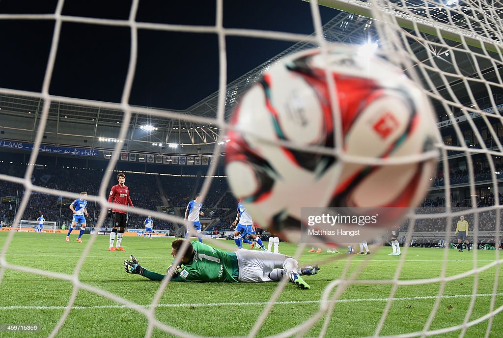 Pirmin Schwegler of Hoffenheim scores his team's first goal past goalkeeper RonRobert Zieler of Hannover during the Bundesliga match between 1899...