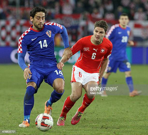 Pirmin Schwegler of Switzerland challenges Mate Males of Croatia during the international friendly match between Switzerland and Croatia at the AFG...