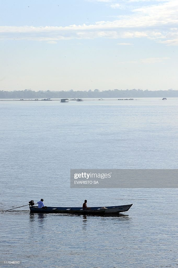 A pirogue crosses the Tocantins River near Maraba, Para state, northern Brazil, on June 19, 2011. The Tocantins river flows northward in central Brazil for 2,640 km through four Brazilian states: Goias, Maranhao, Para and Tocantins, giving its name to the latter, one of Brazil's newest states, formed in 1988 from the northern portion of the state of Goias. AFP PHOTO/Evaristo SA