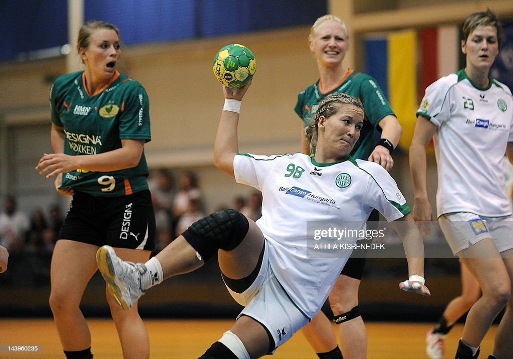 Piroska Szamoranszky (C) of Hungarian FTC Rail Cargo scores a goal between Isabelle Gullden (L) and Rikke Skov (R2) of Danish HK Viborg in Diego sports hall of Dabas on May 6, 2012 during their EHF Cupwinners' Cup final handball match, first leg between their teams as Zsuzsanna Tomori of FTC Rail Cargo watches. AFP PHOTO / ATTILA KISENEDEK
