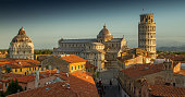 A view of Pisa's Cathedral Square, featuring the Cathedral, the Tower and the Baptistery, taken just after sunrise.