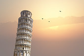 View of historical Pisa Tower in Cathedral Square of Pisa, Italy, on sunrise or sunset sky background.