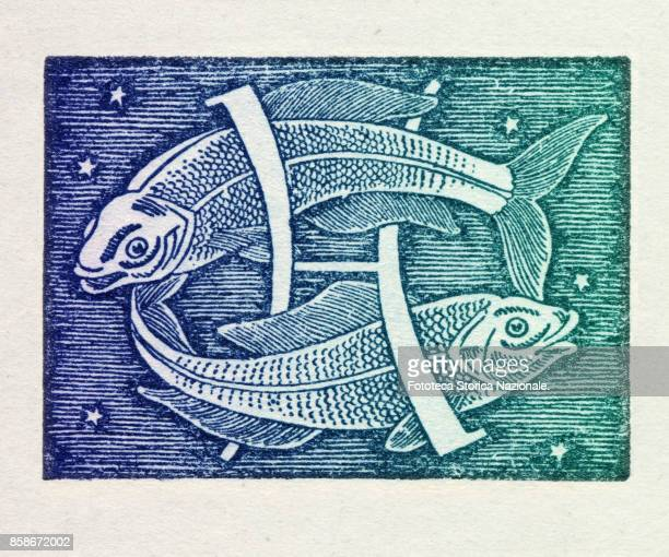 Pisces is the twelfth sign of the zodiac of western astrology mobile and water from 20 February to 20 March Colored version of woodcut of 1942 Italy...