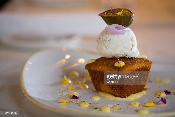 Pistachio cake soaked with orange blossom syrup baklava ice cream topped with roasted fig dressed with orangelemon curd and finally sprinkled in...
