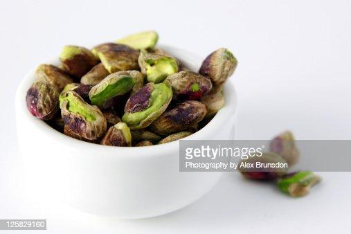 Pistachio nuts in white bowl