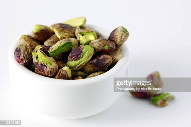 Pistachio nuts in white bowl