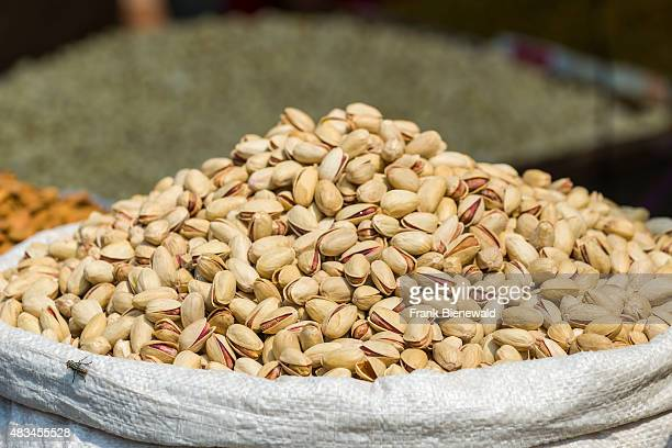 Pistachios are displayed in a sack in the Old Delhi spice market