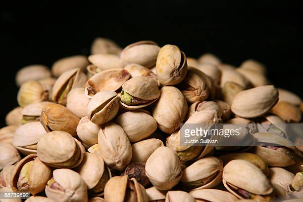 Pistachios sit on a table March 31 2009 in San Francisco California The US Food and Drug Administration is asking consumers to avoid eating...