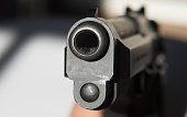 Muzzle and front sight of a 9mm pistol
