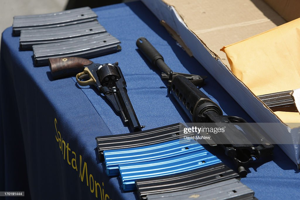 A pistol, part of an AR-15 assault rifle type of gun and ammunition allegedly dropped by a gunman during a mass shooting spree are displayed at the Santa Monica Police Department headquarters on June 8, 2013 in Santa Monica, California. The shootings occurred in various locations about three miles south of a political fundraiser attended by President Barack Obama but Secret Service officials said the two events were not related and that the president was never in any danger. Four people besides the gunman have died from their wounds and five others wounded, including a woman who is close to death.