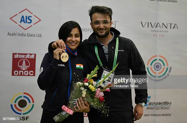 Pistol Shooter Heena Sidhu with her husband Ronak Pandit after winning gold in 10 metre air pistol in Asian Olympic Qualifying Competition at Dr...