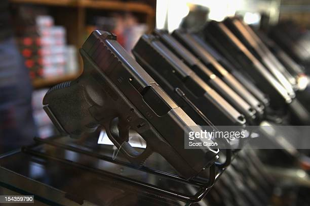 Pistols are offered for sale at Freddie Bear Sports on October 18 2012 in Tinley Park Illinois Facing a $2675 million fiscal 2013 budget gap Cook...