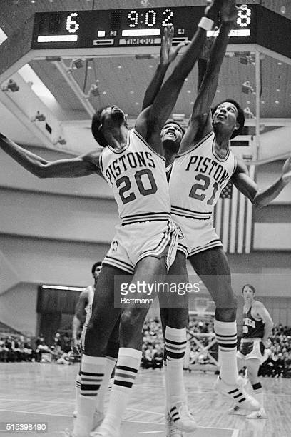 Pistons Otto Moore and Dave Bing team up to squeeze out Rocket Stu Lantz as all went up for a rebound off the Detroit basket during the DetroitSan...