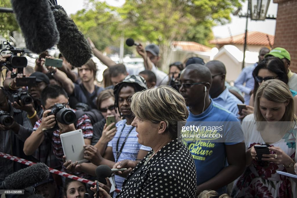 Pistorius family spokeswoman Anneliese Burgess reads a family statement outside Pistorius' uncle's home in Pretoria on October 20 2015 Oscar...
