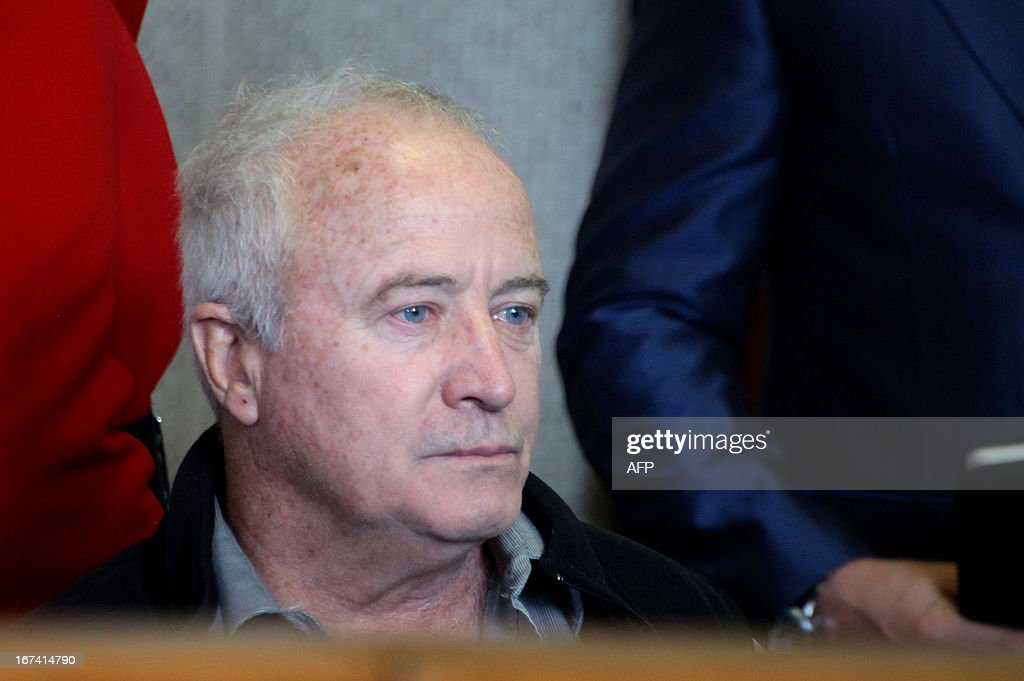 Pistorius's father Henke is pictured on April 25 2013 during the Carl Pistorius trial at the Vanderbijlpark Magistrate's Court in Johannesburg Carl...