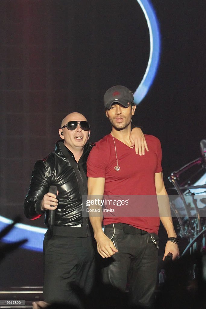 Pit Bull and <a gi-track='captionPersonalityLinkClicked' href=/galleries/search?phrase=Enrique+Iglesias+-+Singer&family=editorial&specificpeople=202672 ng-click='$event.stopPropagation()'>Enrique Iglesias</a> perform at Atlantic City Boardwalk Hall on September 26, 2014 in Atlantic City, New Jersey.