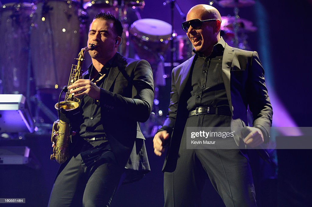Pit Bull (R) performs at DIRECTV'S 7th annual celebrity Beach Bowl at DTV SuperFan Stadium at Mardi Gras World on February 2, 2013 in New Orleans, Louisiana.