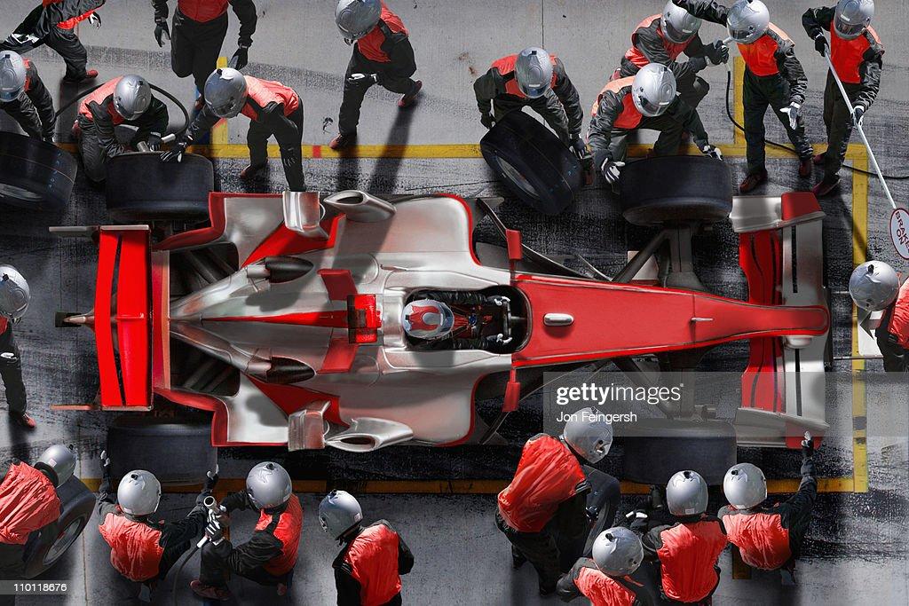 F1 pit crew working on F1 car.