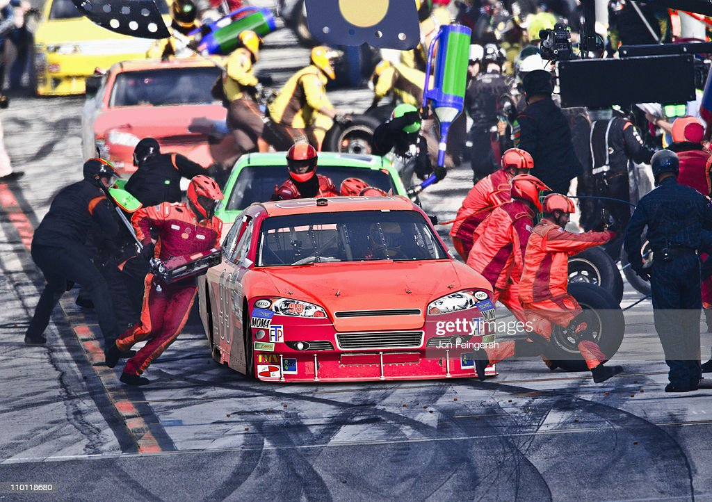 Pit Crew working on Race Car. : Stock Photo