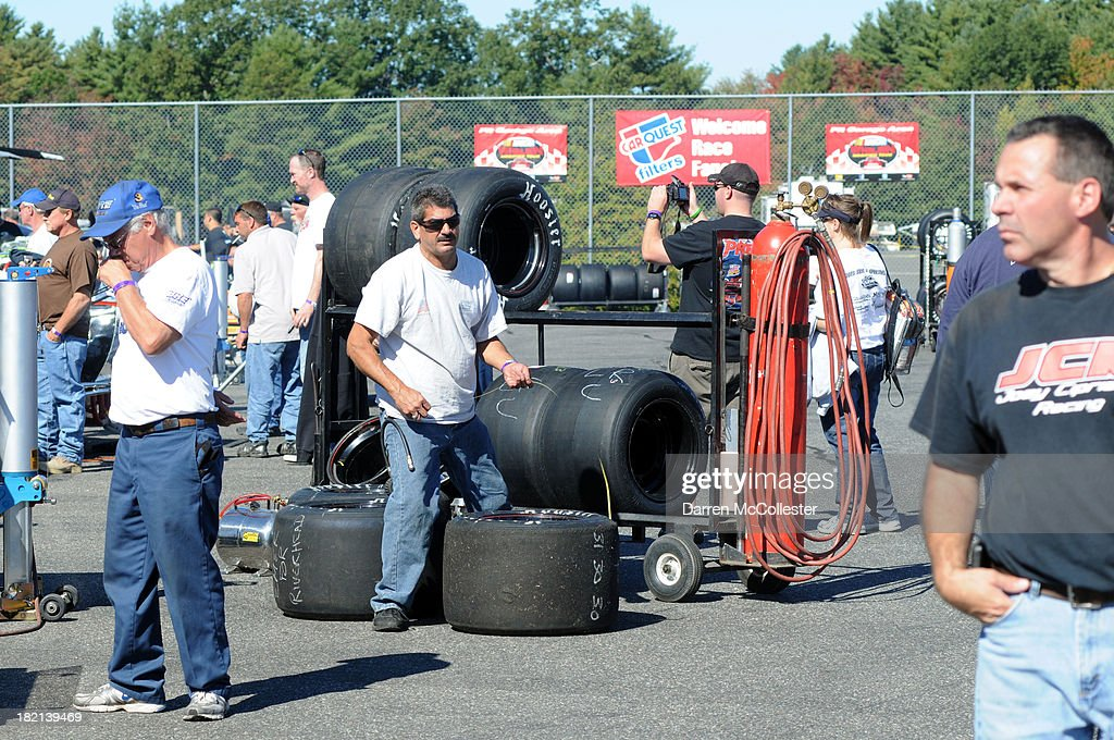 Pit crews and spectators in hang out in the pits prior to practice at the CARQUEST Fall Final at Stafford Motor Speedway September 28, 2013 in Stafford, Connecticut.