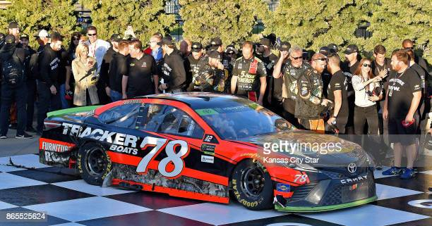 Pit crews from the number 77 Erik Jones car and number 78 Martin Truex Jr car gathered in victory lane to celebrate the win by Truex on Sunday Oct 22...