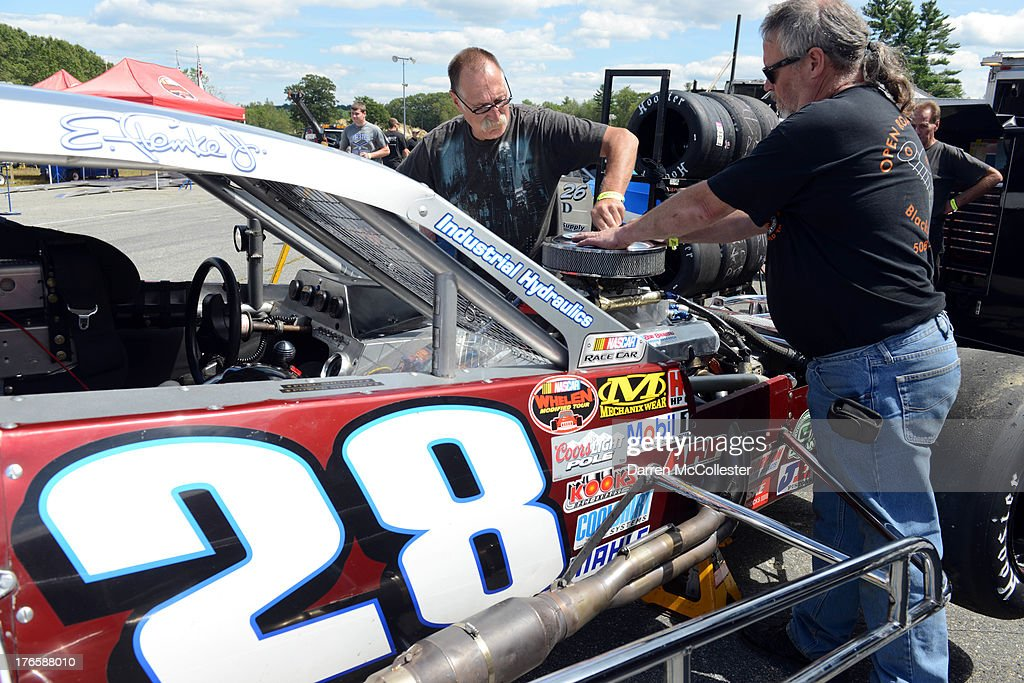 Pit crews prepare the #28 Ron Bouchard's Auto Stores Chevrolet car driven by Ed Flemke Jr., in pit lane prior to the Budweiser King of Beers 150 at Thompson Speedway August 15, 2013 in Thompson, Connecticut.