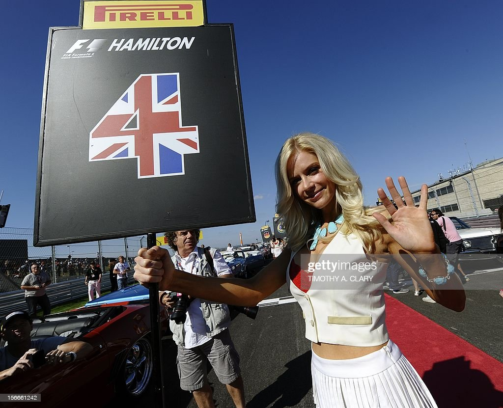A pit girl holds a sign for Vodafone McLaren Mercedes driver Lewis Hamilton of Britain during the drivers' parade during the United States Formula One Grand Prix at the Circuit of the Americas on November 18, 2012 in Austin, Texas.