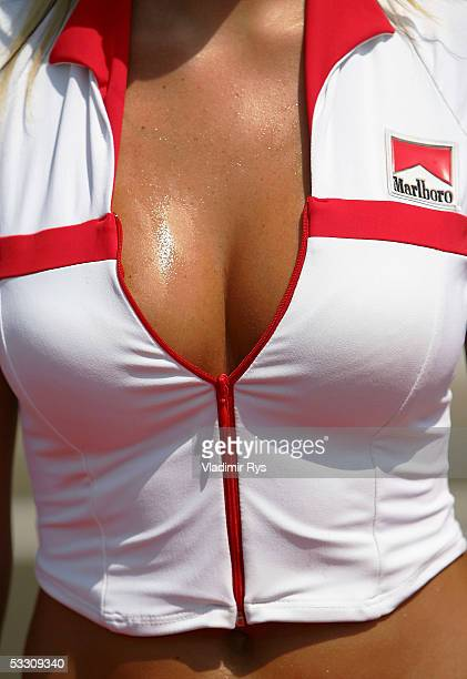 A pit girl perspires during a drivers parade prior the Hungarian F1 Grand Prix on July 31 2005 in Budapest Hungary