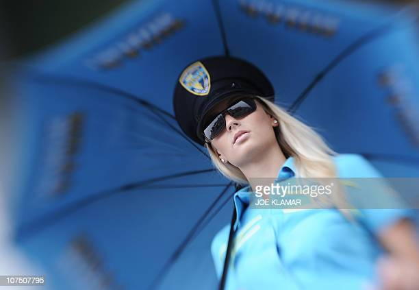 A pit girl stands in the paddock during the qualifying run of the MotoGP event during the Czech Grand Prix in Brno on August 142010 AFP PHOTO /JOE...