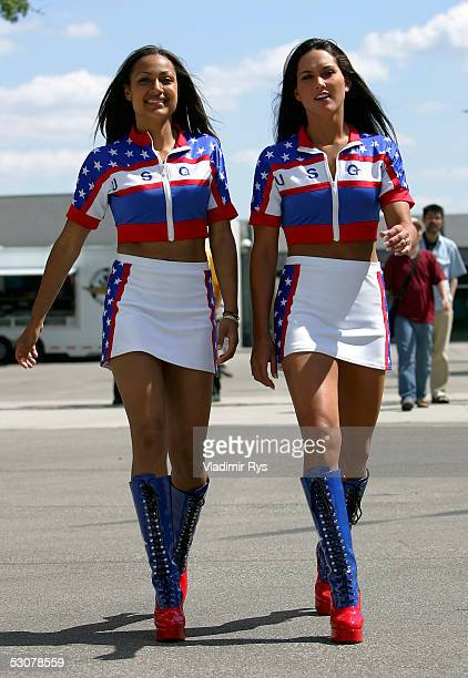 Pit girls are seen walking in the paddock during the previews to the US F1 Grand Prix on June 16 2005 in Indianapolis Indiana