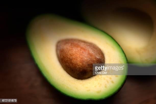 Pit in sliced avocado