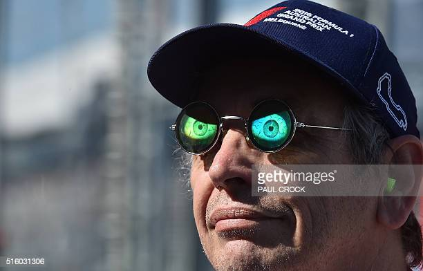 A pit lane fire marshall keeps an eye on teams preparing their cars ahead of the Australian Formula One Grand Prix in Melbourne on March 17 2016 /...