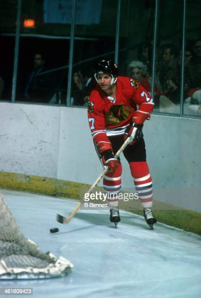 Pit Martin of the Chicago Blackhawks skates with the puck around the net during an NHL game against the New York Rangers on February 19 1975 at the...