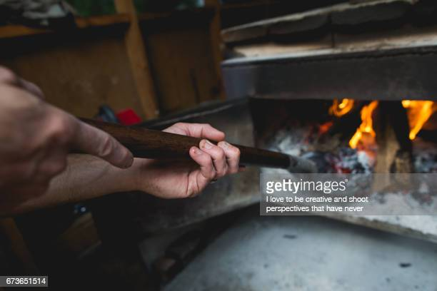 Pit master tending Fire