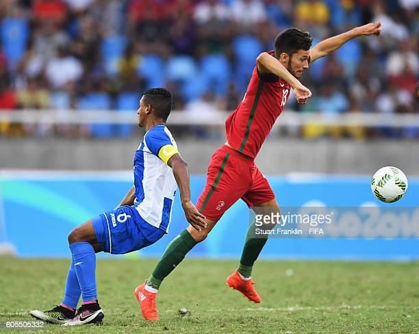 Pita of Portugal is challenged by Bryan Acosta of Honduras during the Olympic Men's Football match between Honduras and Portugal at Olympic Stadium...