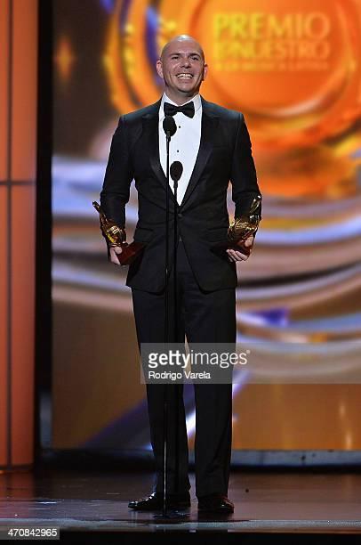 Pitbull accepts an award onstage at Premio Lo Nuestro a la Musica Latina 2014 at American Airlines Arena on February 20 2014 in Miami Florida